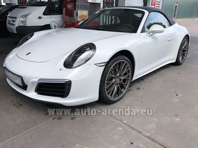 Hire and delivery to Grenoble Isère Aéroport (GNB) the car Porsche 911 Carrera Cabrio White
